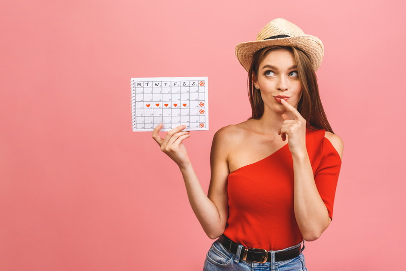 portrait-funny-young-girl-holding-periods-calendar-isolated-pink-background.jpg